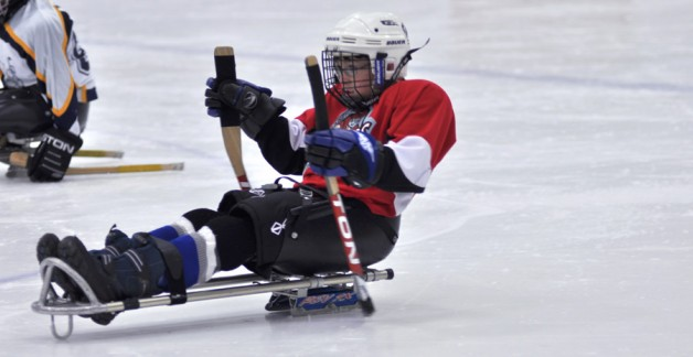 Logan playing sledge hockey.