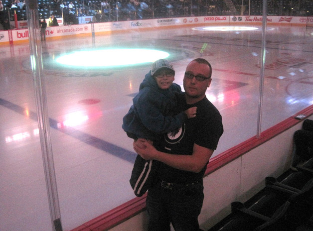 Sklyar and his dad at the Jets home opener.