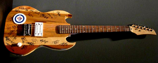 Win a hand-crafted guitar signed by the Winnipeg Jets.