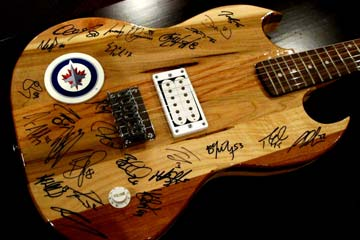 Bid to own a guitar signed by the Winnipeg Jets!