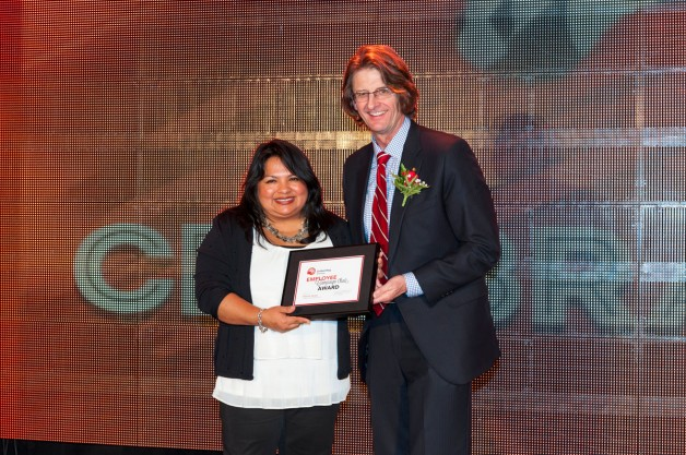 Immigrant Centre Manitoba Inc. received an award on behalf of Etiene Serpa