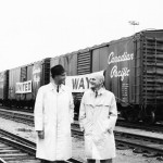 Taken a the Canadian Pacific Railyards in 1965, United Way's first Board Chair George T. Richardson stands with inaugural Campaign Chair William Palk.