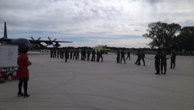 17 Wing kicks off their United Way Campaign pulling a Hercules.