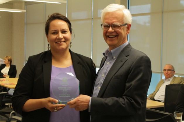 Christine Cyr receives an award from Herb Peters recognizing her community leadership