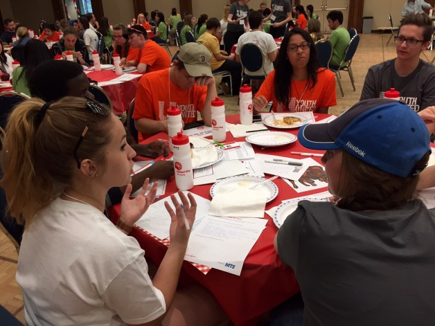 Youth United hold a Red Table lunch at their 2015 Day of Caring.