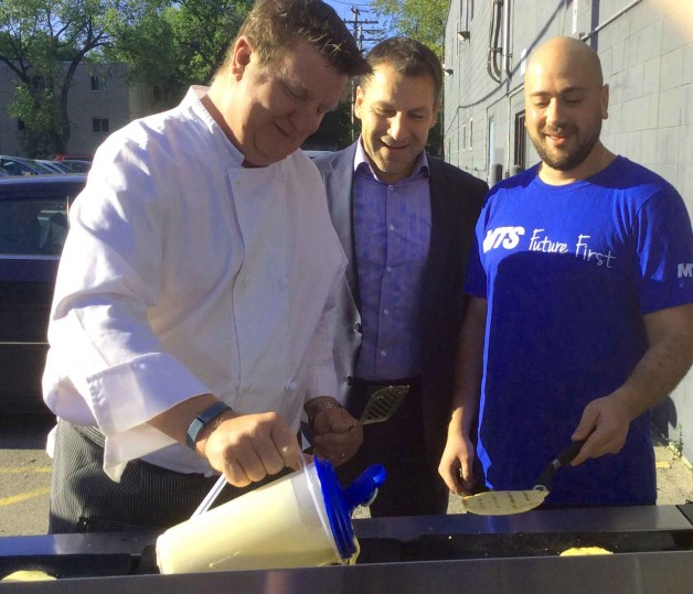 Bill Yaeger, Arnie Fedorchuk, and Gavriel Sierra share a moment BBQ'ing pancakes