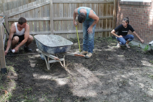 Measuring the grade. Barkman removed 50 wheelbarrows of dirt to make room for a new base and paving stones.