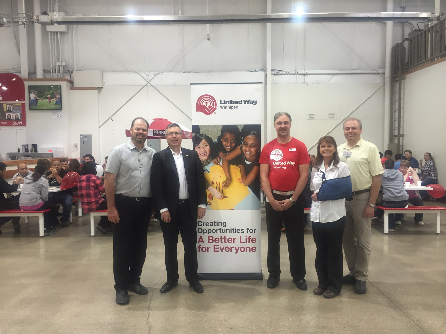 breakfast at costco united way of winnipeg flanking a united way banner from left was costco general manager jerry millar