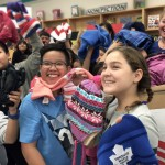 Grades 5 & 6 students at Sister MacNamara School help 103.1 Virgin's Chrissy Troy and CTV's Colleen Bready load up the Koats for Kids donation box.