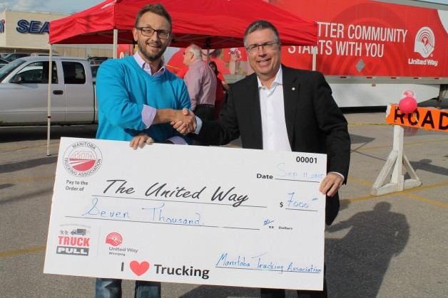 MTA executive director Terry Shaw presents a giant cheque to United Way 2015 Campaign Chair Kelvin Shepherd.