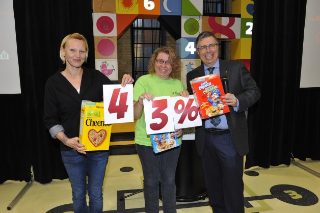 Leah McGuiness, left, and Debbie Kutzan from Plessis Road Family Resource Centre pull 2015 Campaign progress out of cereal boxes.