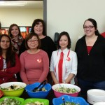 Monsanto's United Way campaign team poses behind a delicious salad bar.