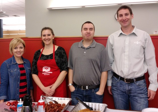 The SMS United Way campaign committee, from left, Sheila, Bridget, Andrew, and Jason, with breakfast.