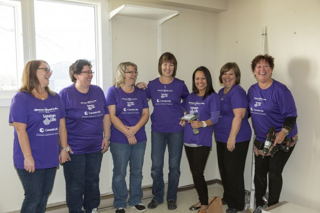 Helpers at the Fort Garry Women's Resource Centre, where they installed a closet system and organized items.
