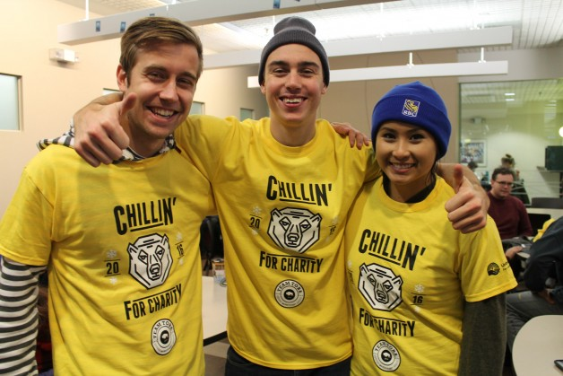 Tom Toni, Ben Kuilman, and Victoria Truong recover from the chill indoors in their new Team Toba Ts, awarded for raising at least $250. each