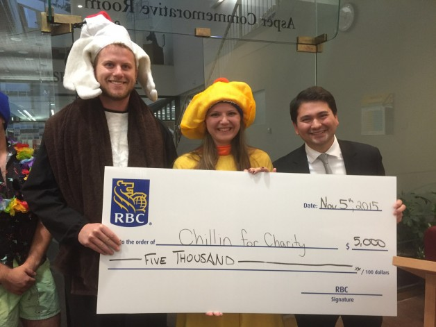 RBC's Aaron Martyniw presents a cheque to Katharyn and Keith.