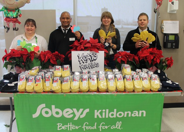 Sobeys Engagement Champion Jennifer Downey (from left), Assistant Manager Rex Quilapio, United Way Community Involvement Associate Mariah Baldwin, and Manager Scott Innes with 254 pairs of hockey mitts destined to keep kids hands warm.