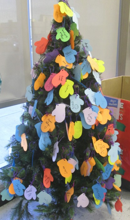 The Christmas tree with little paper mitts displayed names of generous donors.