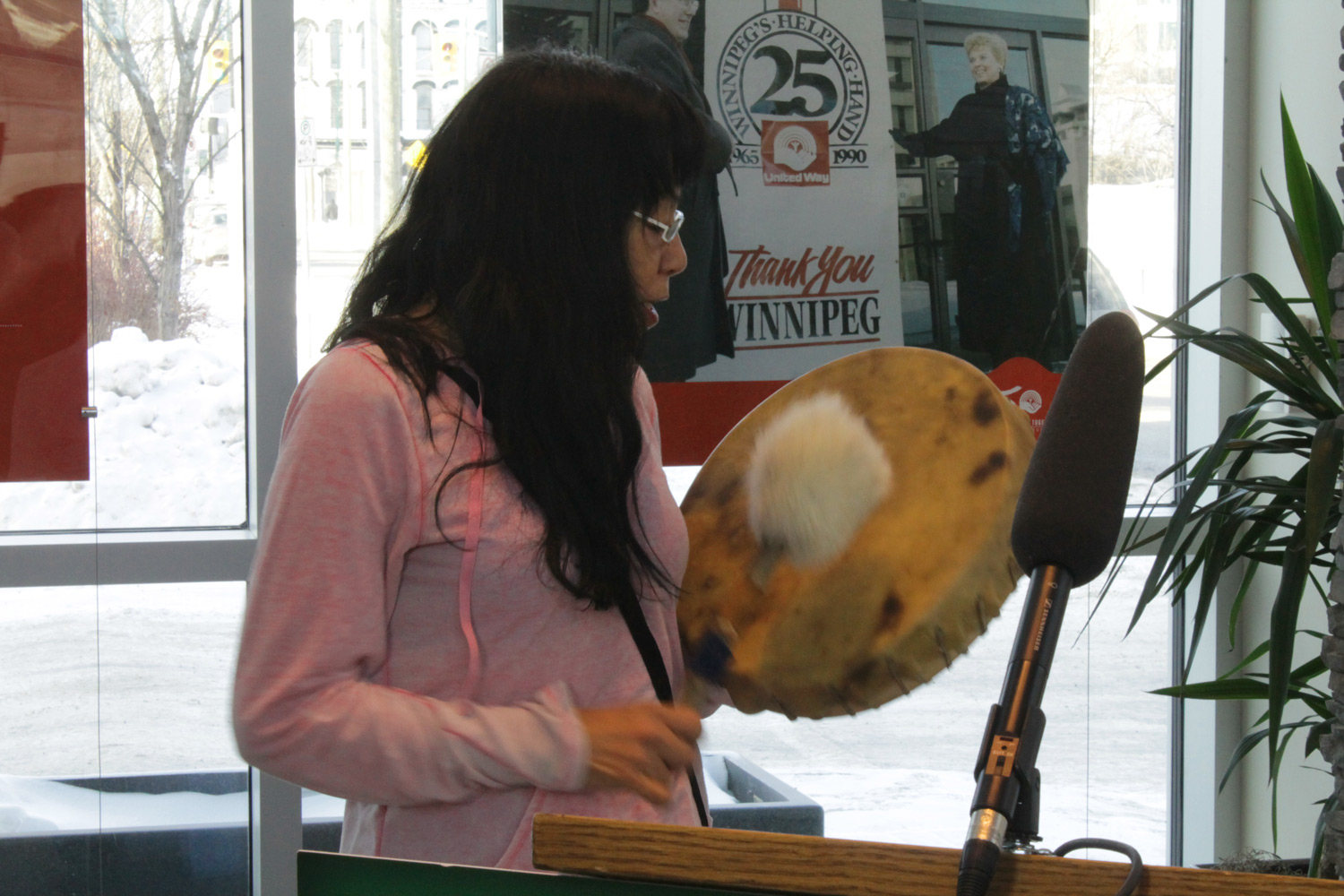 Elaine David of the North End Women's Centre's Buffalo Gals drum group closed the day with a Humbling Song.