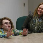 At right, Wendy (mom) and Jordana Kilgour, daughter,18, at the Circle of Friends program at St. James Collegiate. This is a weekly session where Jordana learns to interact with people her own age. WAYNE GLOWACKI / WINNIPEG FREE PRESS