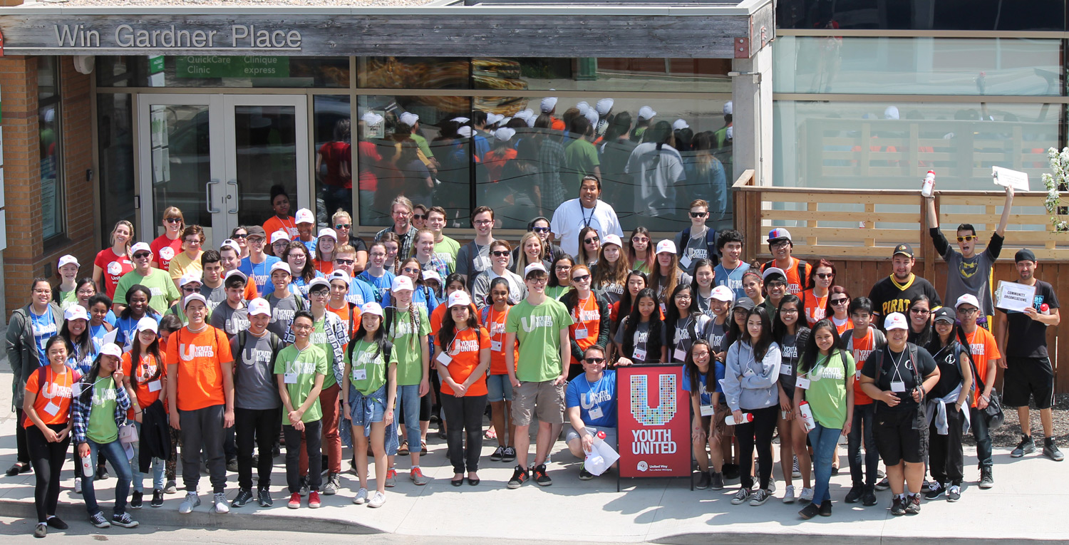 Youth United Day of Caring volunteers and AYO members outside Ma Mawi at Win Gardner Place.