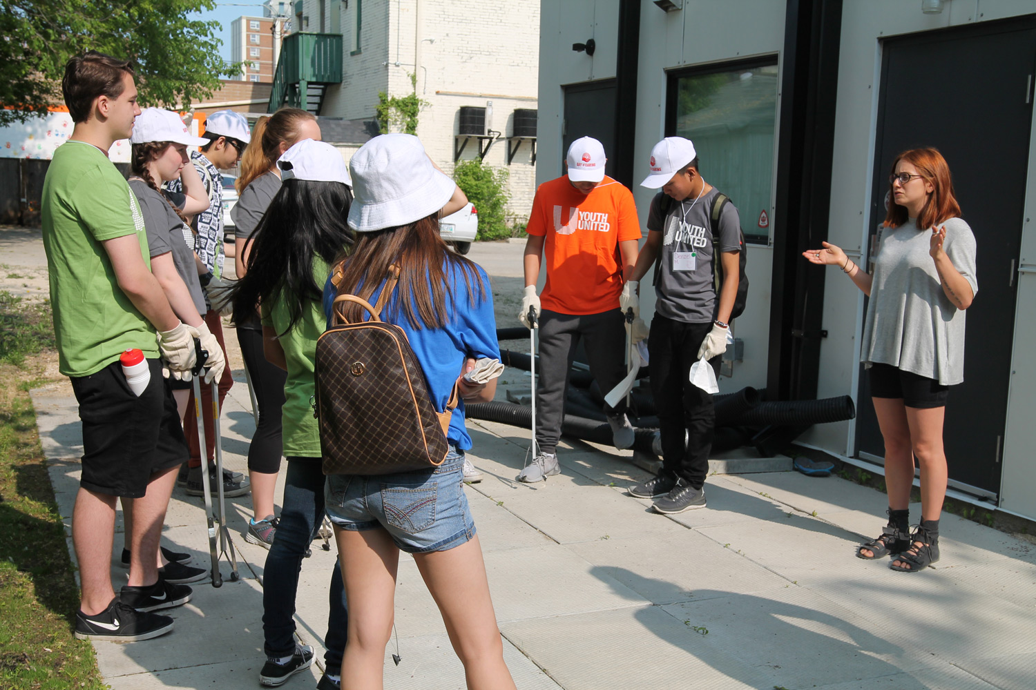 North End Women's Centre's Marissa Rykiss talks to youth before they start work.
