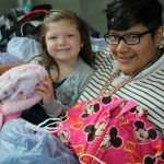 Braelyn, with her aunt Shania, made her birthday about compassion and caring for kids.