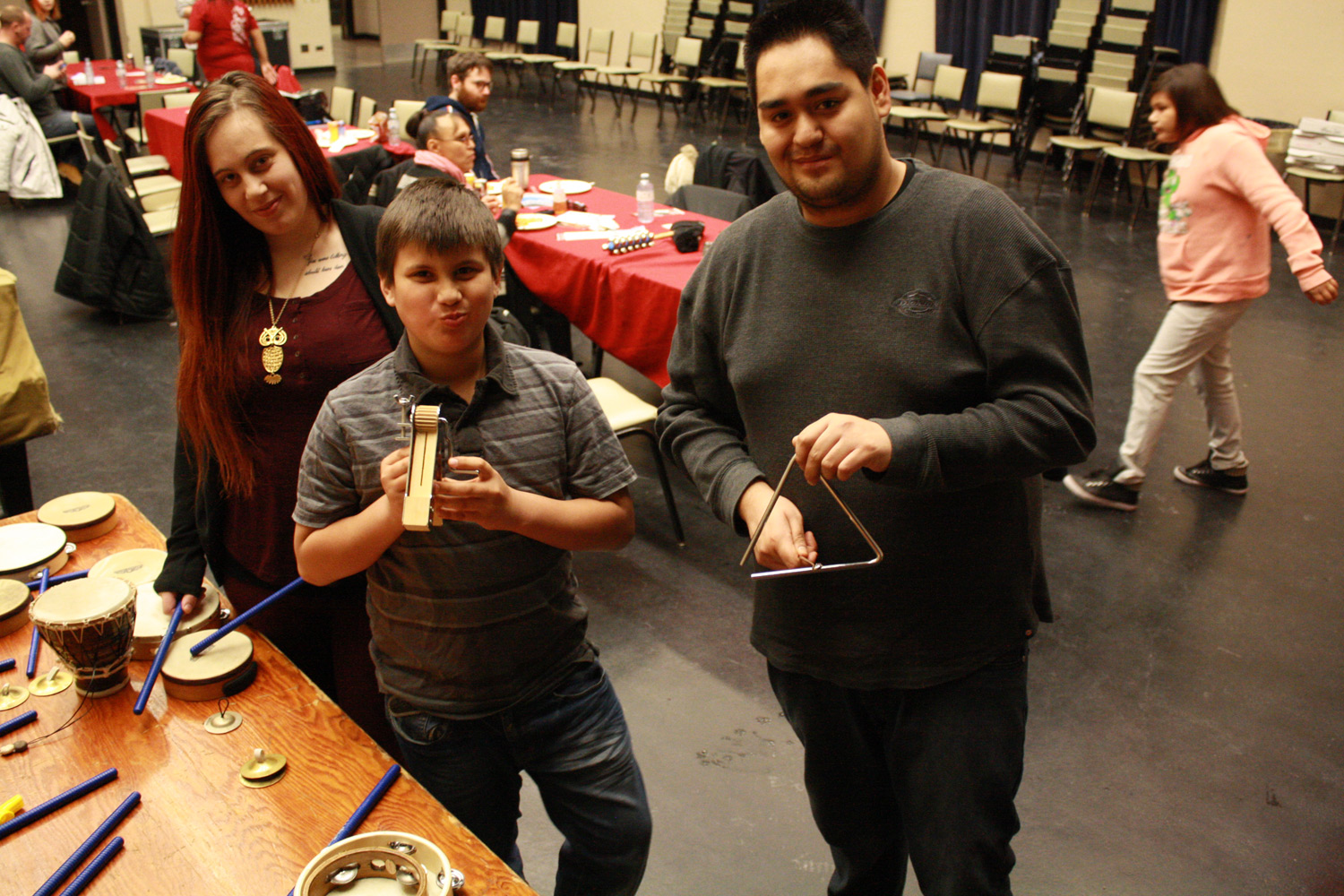 Miranda, Darrin and son Ayden try out some percussion instruments backstage at the Winnipeg Symphony Orchestra.