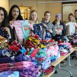Students from Asper School of Business' Team Toba sorted PJs into age groups.