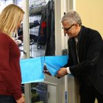 Canadian Footwear co-owner Brian Scharfstein cuts the ribbon on the new We Fit You Closet.