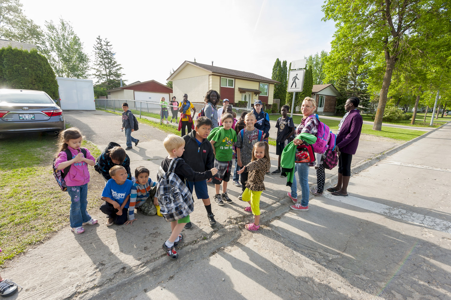 Leah gets some help making sure the walking school bus crosses a road safely. DOUG LITTLE PHOTOGRAPHY