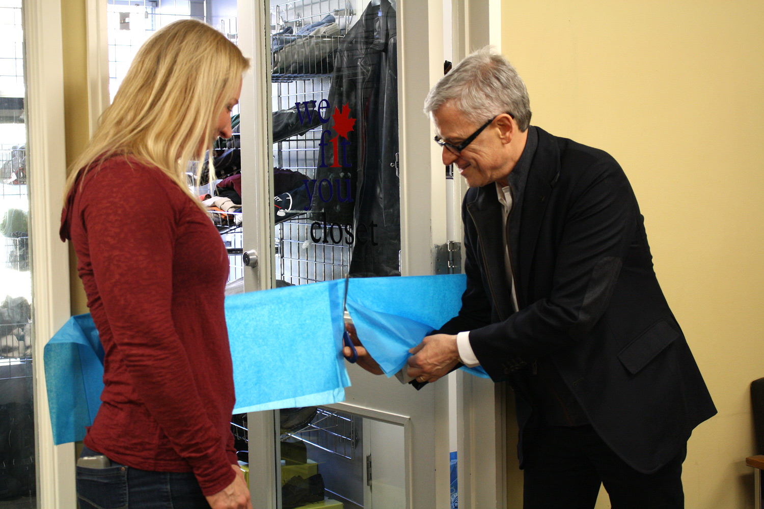 Canadian Footwear co-owner Brian Scharfstein cuts the ribbon on the new We Fit You Closet with help from Tania Weibe, coordinator of reintegration at JHS