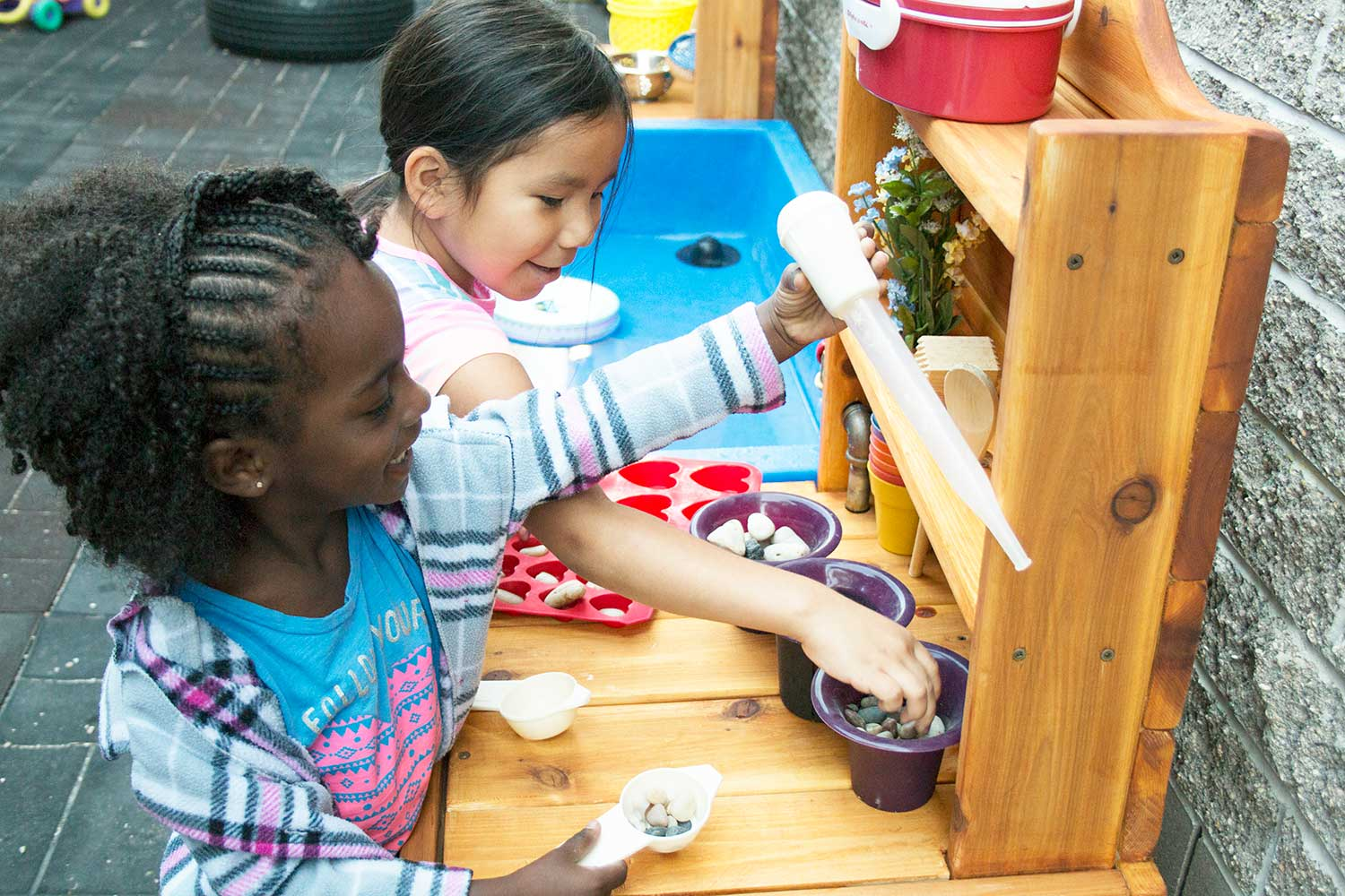 Kids start cooking up fun and creativity with their new mud kitchen at Thrive Child Care.