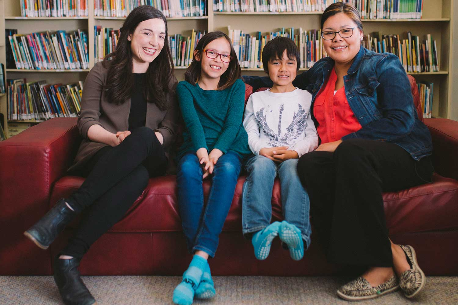 Mom Jayce, right, is grateful Chase and Nadine were able to increase their reading levels with help from a United Way program. Alix, left, volunteers her time with kids and donates to United Way.