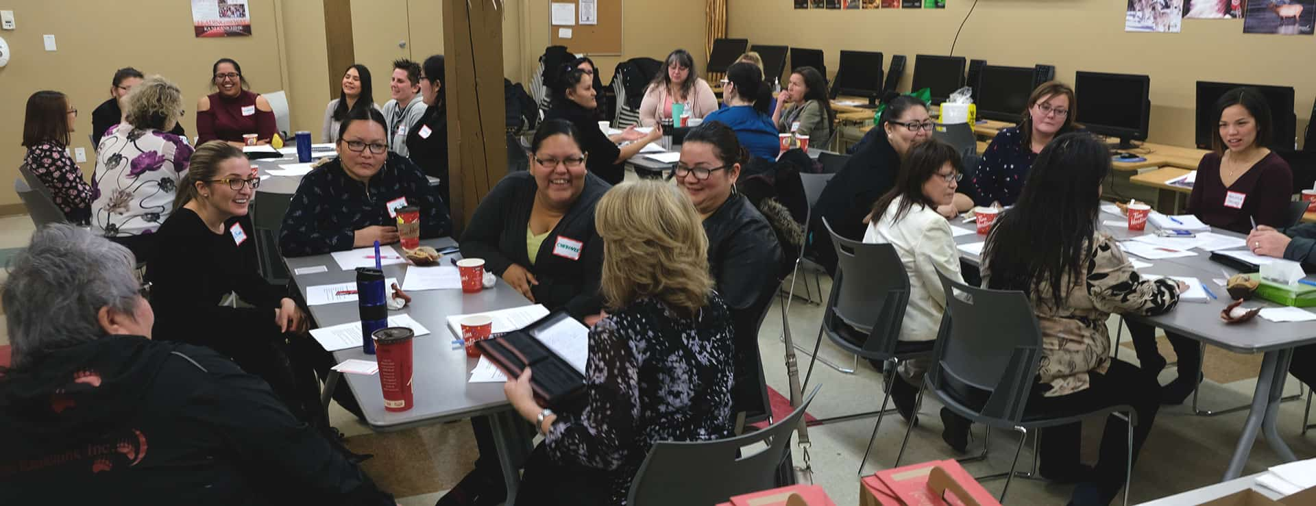 Employers meet with job-training participants in conversation circles.