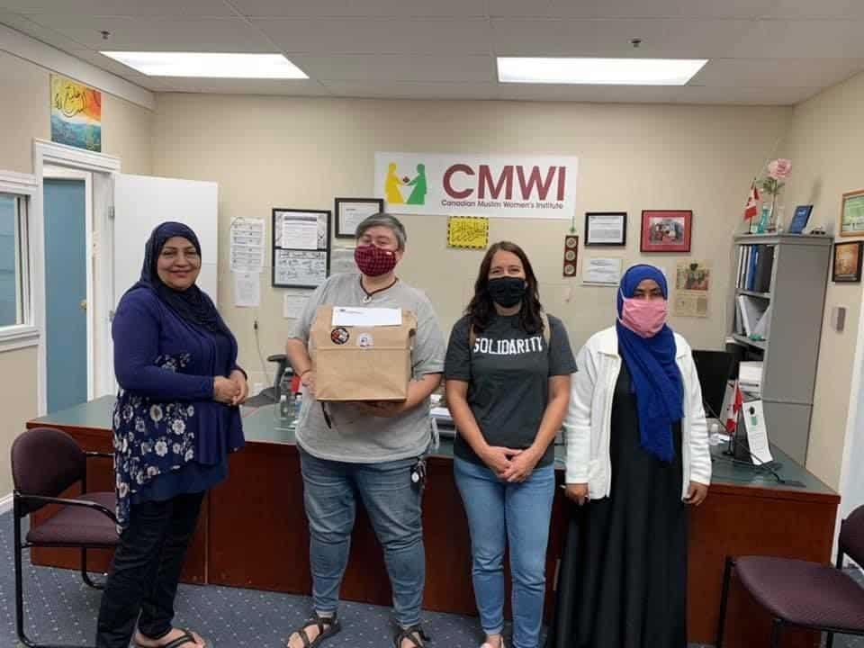 The Canadian Muslim Women's Institute receives a donation package as part of the Winnipeg Labour Council's #126donations initiative.